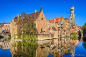The Rozenhoedkaai in Bruges, Belgium with reflections in the water of the Dijver