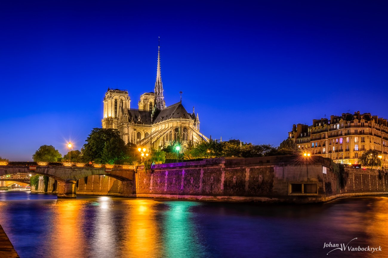 The Notre Dame in Paris, France by night as seen from the other side of the Seine