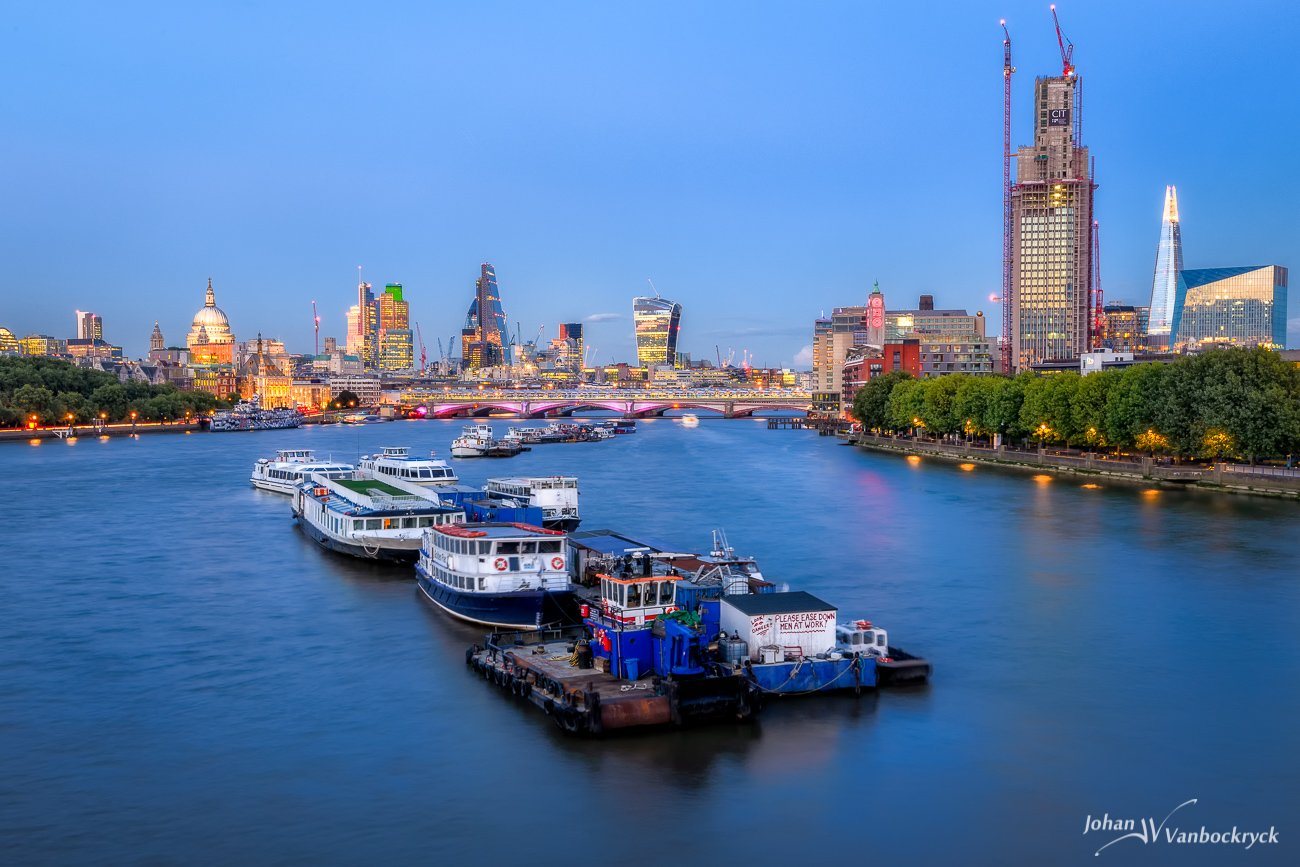 A twilight/night view of the skyline of London as seen from the Waterloo Bridge
