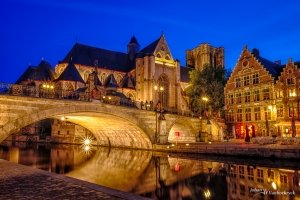 The Saint Michael's Church in Ghent, Belgium during the night as seen from the Graslei