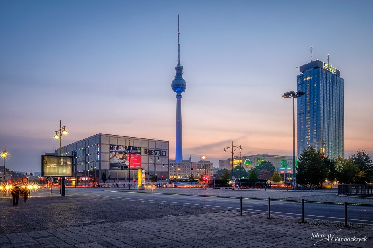 A view of Alexanderplatz in Berlin, Germany during dusk/sunset with the Park Inn and the Fernsehturm