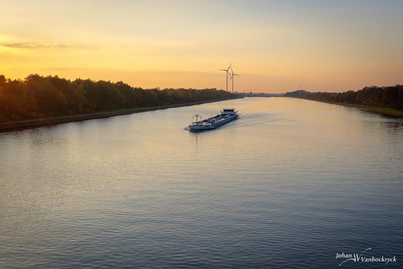 A barge in the Albertkanaal in Godsheide, Hasselt, Belgium during sunset
