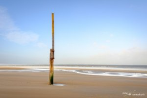 A tide pole on the beach of Koksijde, Belgium