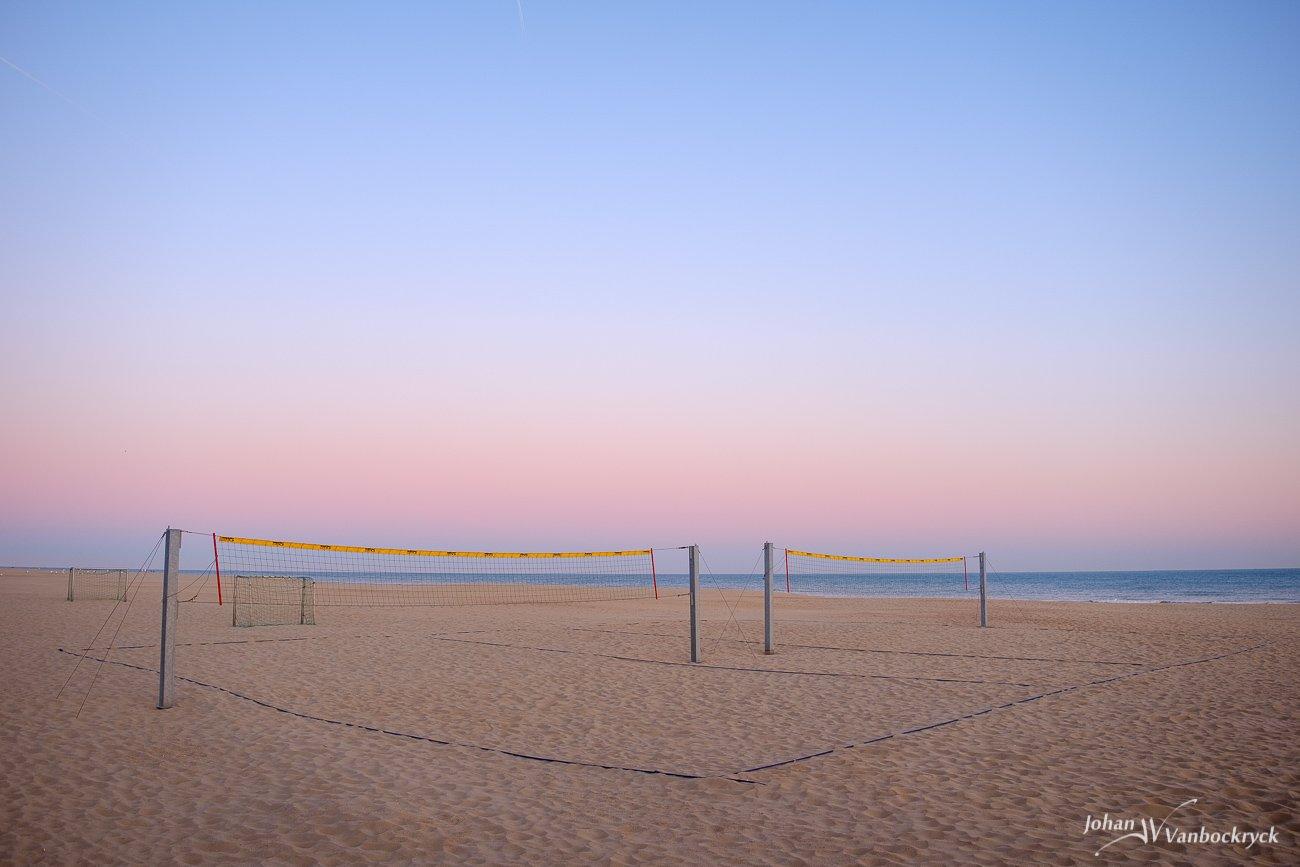 A volleyball field on the beach of Koksijde, Belgium during dawn/sunrise