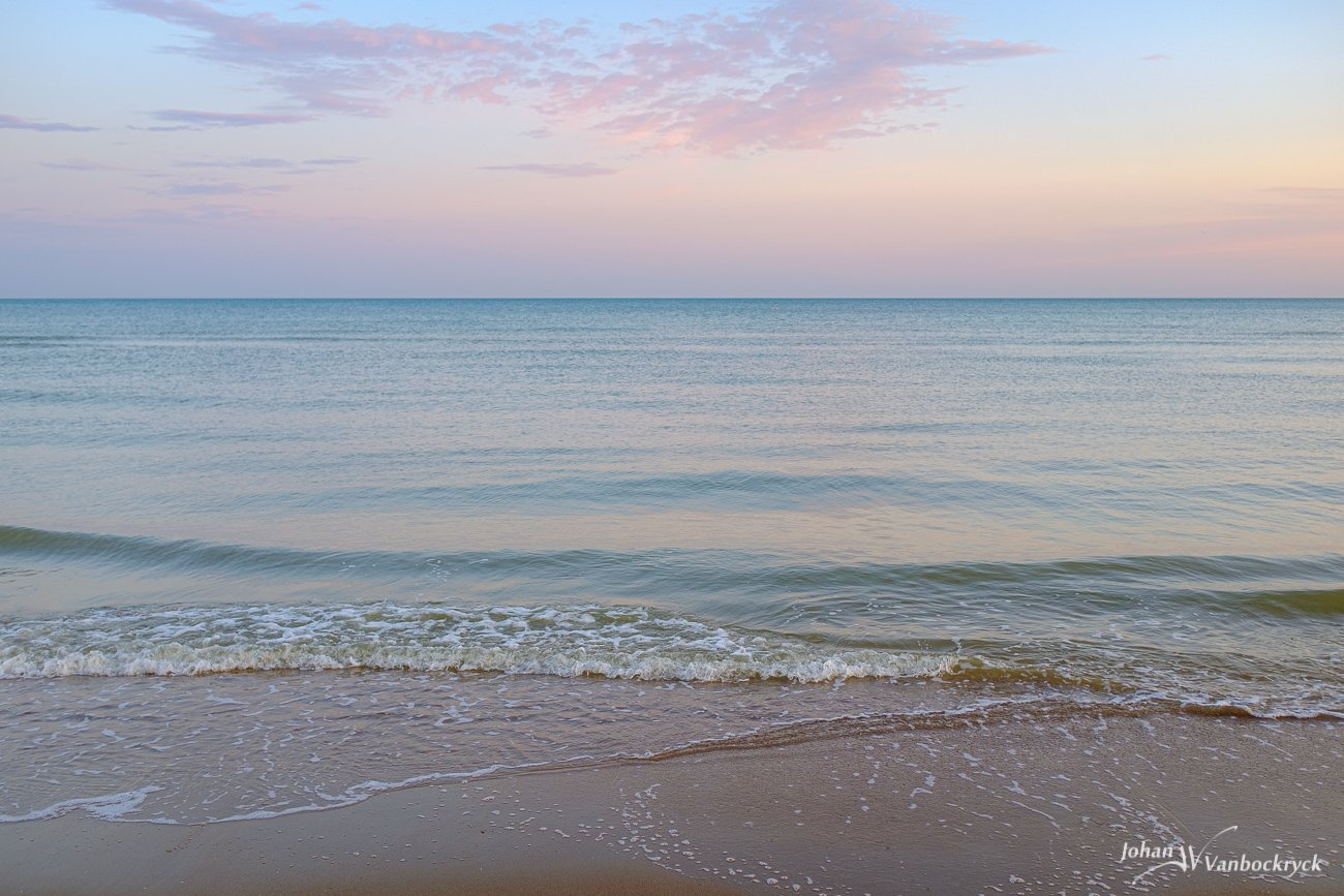 The waves on the beach of Koksijde, Belgium during sunrise