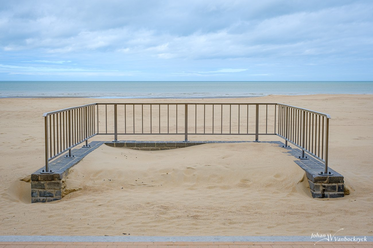 A small fence structure on the beach of Koksijde, Belgium